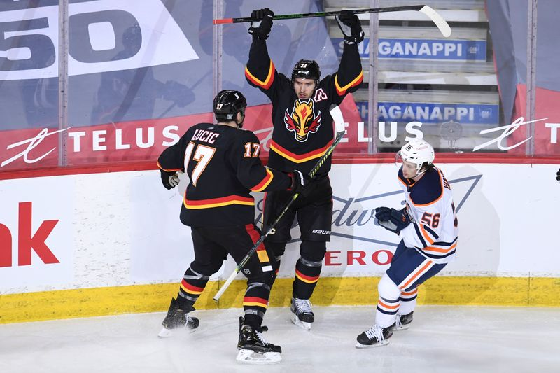 Flames edge Oilers in scoring frenzy By Reuters